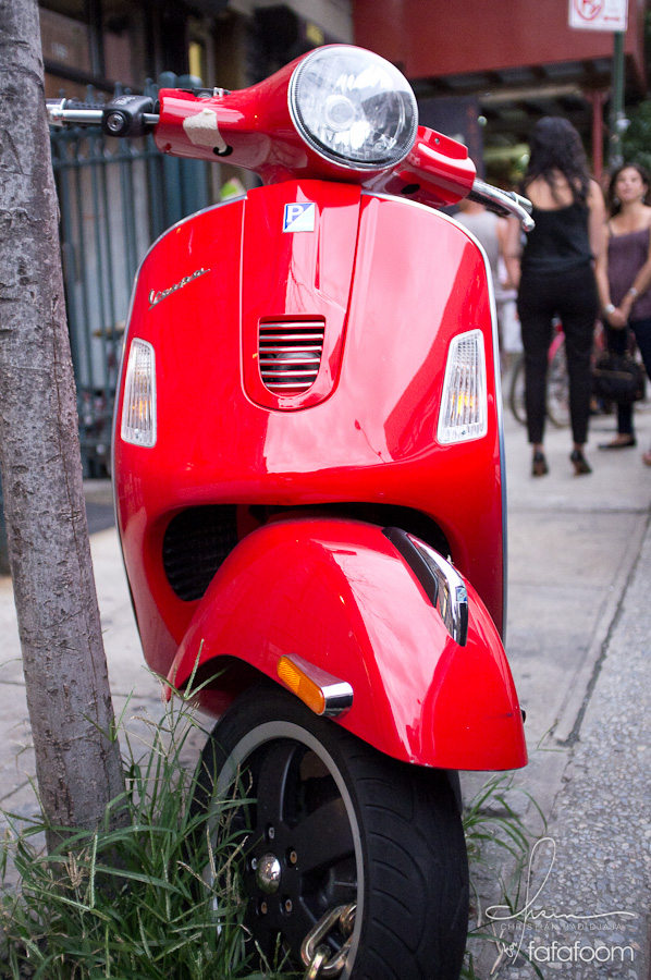 Red Vespa in front of Grand Opening