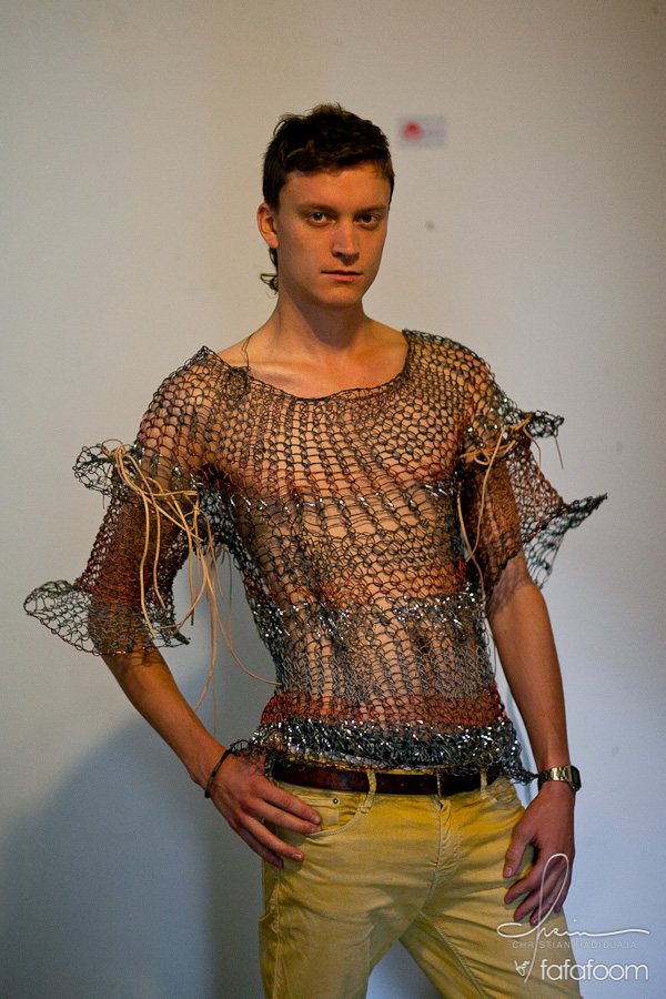 A model wearing Tuan Tran's wired top