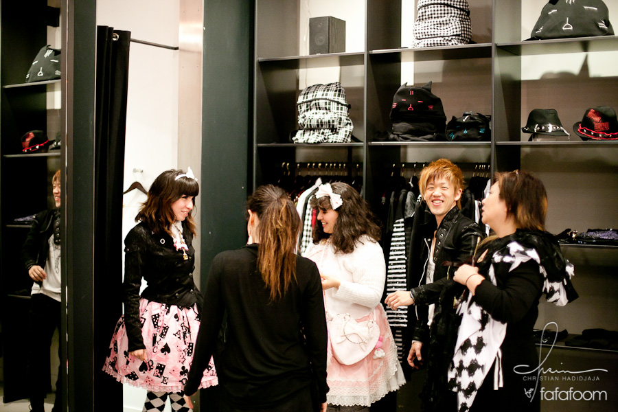 Naoto Hirooka helping customers at his store